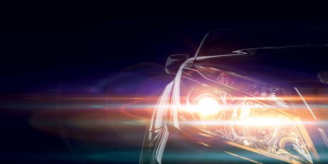 An artistic photograph of some car headlights