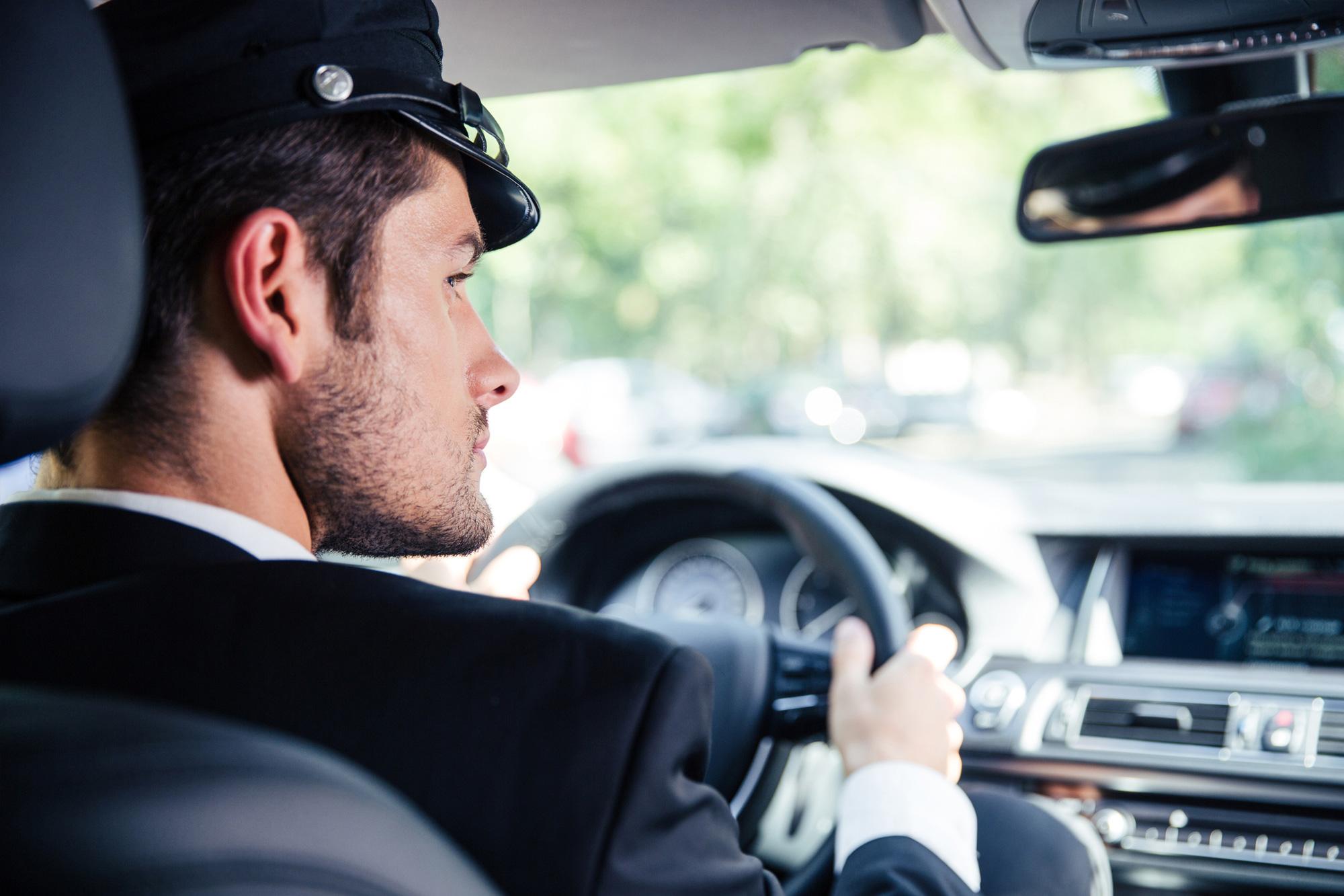 A Chauffeur driving a car