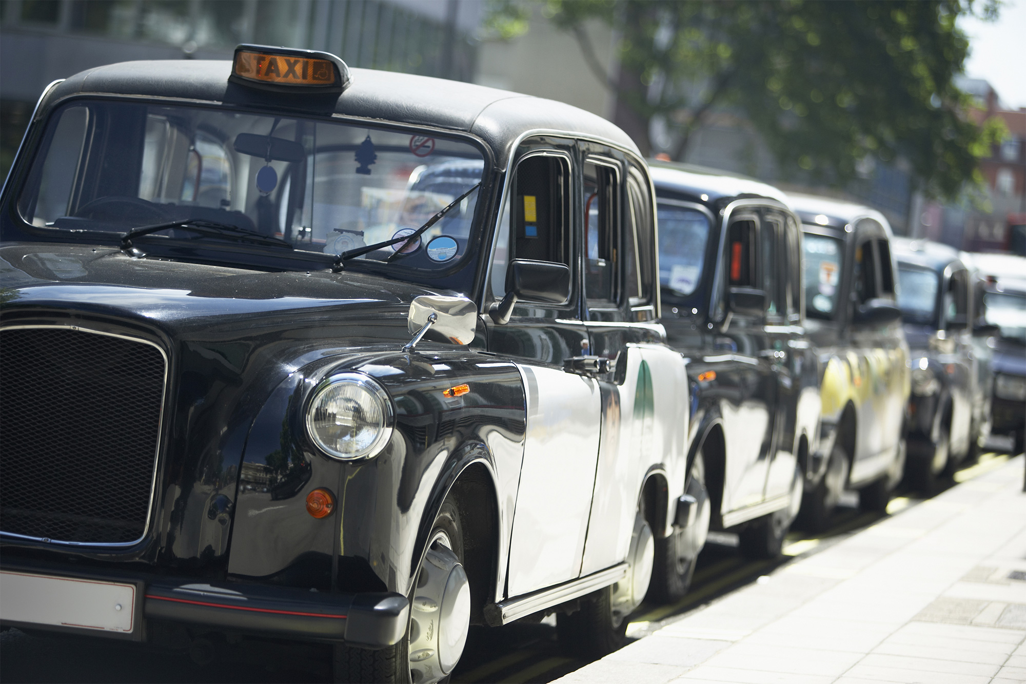 A row of black London Taxis