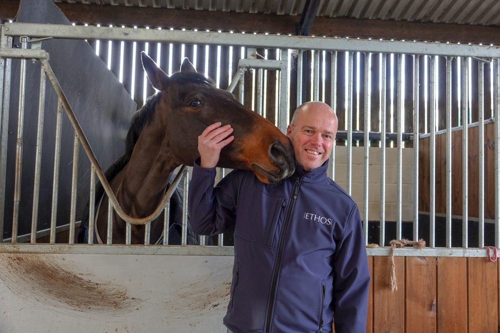 Ethos CEO, Chris Brown with a horse
